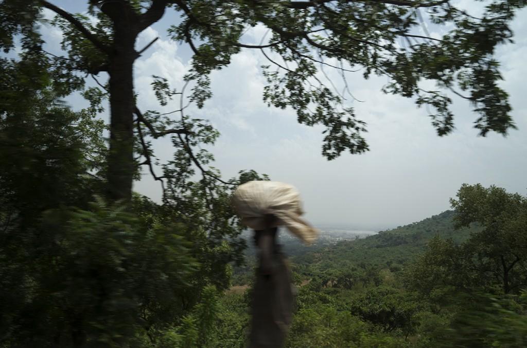 A pedestrian walks along the road to Koulouba.