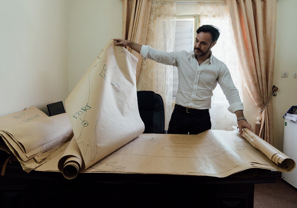 Hernando, in his office, looks through drawings created by victims of conflict. October 2017 (Hannah Dunphy/JRR)